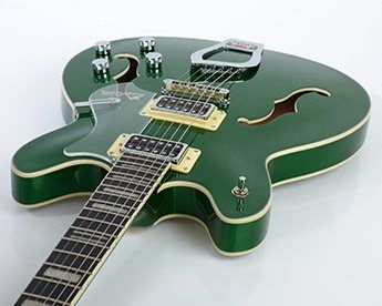 Emerald Green with Ivory Bindings and Pickup Surrounds